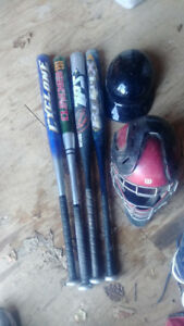 Assorted bats and catcher's gear