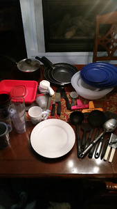 Lot of dishes, glasses, pot, pans, bowls, serving spoons!
