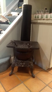 1900's POT BELLY STOVE - STAR 150