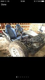 Buggy frame project with leather bucket seats and wheels