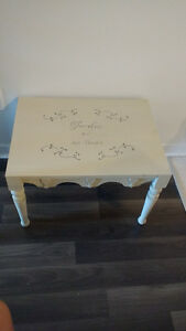 Small antique table in lightly distressed cream