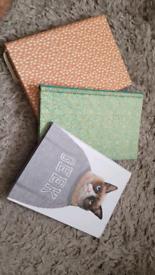 3 blank notebooks