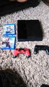Ps4 with 2 controllers and 2 games