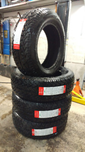 New 225/65R17 all season A/T tires, $450 for 4
