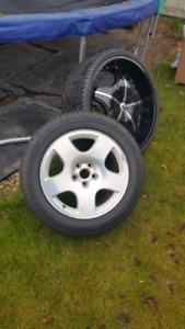 "Cast aluminum like new 17"" Audi rims and tires all season"