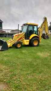 new holland backhoe 4x4 turbo extend a  hoe