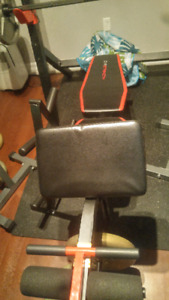 Olympic bench press/squat rack + Olympic barbell/weights