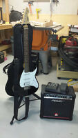 PEAVEY RAPTOR EXP ELECTRIC GUITAR - INCL CASE, STAND, PEAVEY AMP