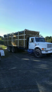 Taking orders for loads of square baled straw