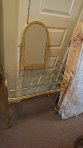 Glass and brass make up stand
