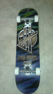 Brand new complete skateboard  (paid$250) selling for $100