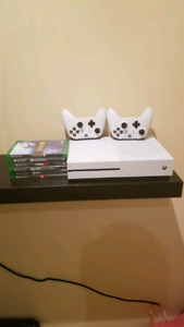 Xbox 1s 1 tb with 8 games,2 controls and guitar for guitar hero.