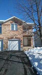 End Unit Walk-out Townhouse in Orleans backing onto ravine