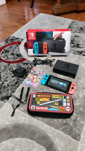 Nintendo switch with games and case