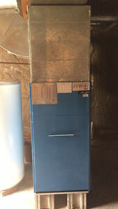 Forced air furnace, oil tank and the ducts