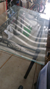 Glass table top with black metal frame