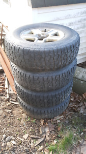 4 225/75/15 mud and snow tires on Tracker rims