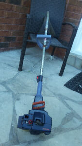Gas trimmer Husqvarna Mondo in good condition with manual