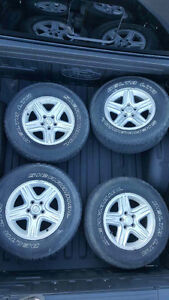 Set of jeep rims with tires