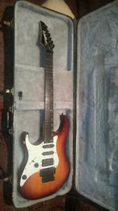 Left handed Washburn MG 40 electric guitar