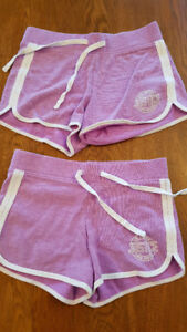 2 pairs of mauve Justice shorts