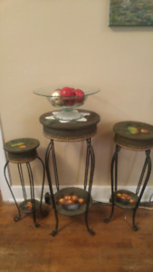 Three matching round tables with classy metal legs