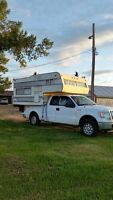 Older truck camper. Perfect for hunting!
