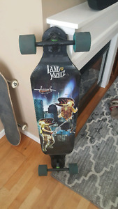 Two skateboards and a helmet for sale