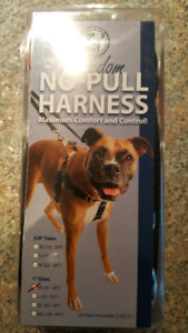 No Pull Harness size medium.  With coupler leash coupler