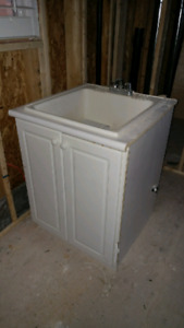 Laundry utility tub with faucet and plumbing rough in