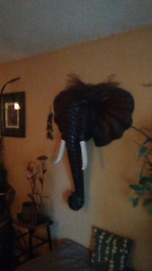 Large teak elephant head and other asorted native/african masks