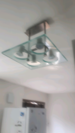 Glass ceiling light with led bulbs and satin metal finish.