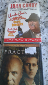 Still in package , two CO'S.   John Candy 3 movies.