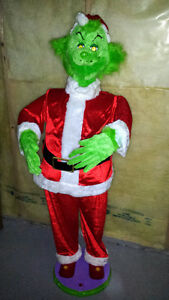 Grinch, sings and dances