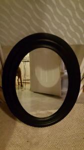 Black wooden oval mirror