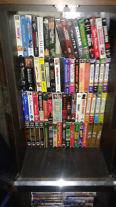 Vhs movies includes glass cabinet