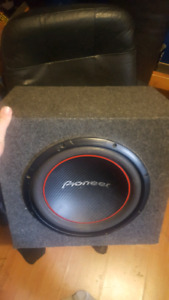 """12"""" pioneer subwoofer with box."""
