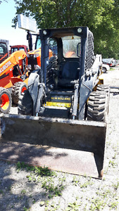 (2) New Holland L220 Skid Steers