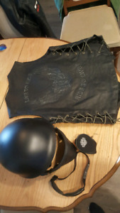Leather jacket vest glasses and helmet