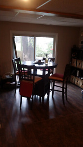 Wine lovers look! Solid wood dining/entertainment table,chairs.