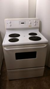 Frigidaire stove and Amana Fridge