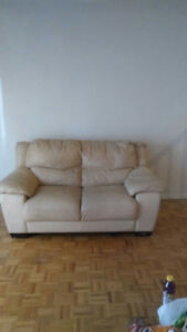 Used genuine leather love seat and chair for sale.