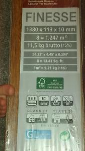 10mm Walnut Laminate Flooring - 147 sq feet