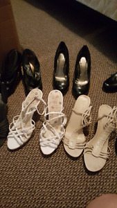 Multiple pairs of high heel shoes