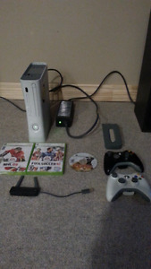 Xbox 360 4 games and 2 controllers. Wifi. Kinect. $50