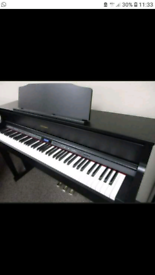 Roland HP605 digital piano with FREE new matching stool. RRP £2000.