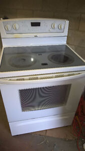 Washer, dryer, flat top electric self-cleaning oven, freezer.