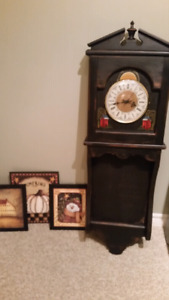 Long primitive  clock and small cabinet