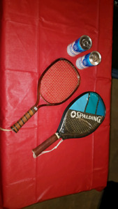 Two racquetball racquets and two cans of balls new