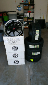 Set of rims and tires never used! Still in box. $950 obo